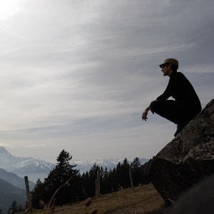 A picture of Ari Scheller hiking in the swiss apls