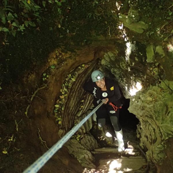 Ari Scheller decending into the glow worm caves in New Zealand